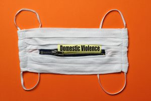mask with text that says domestic violence