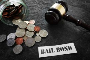 gavel with money and sign for bail bonds
